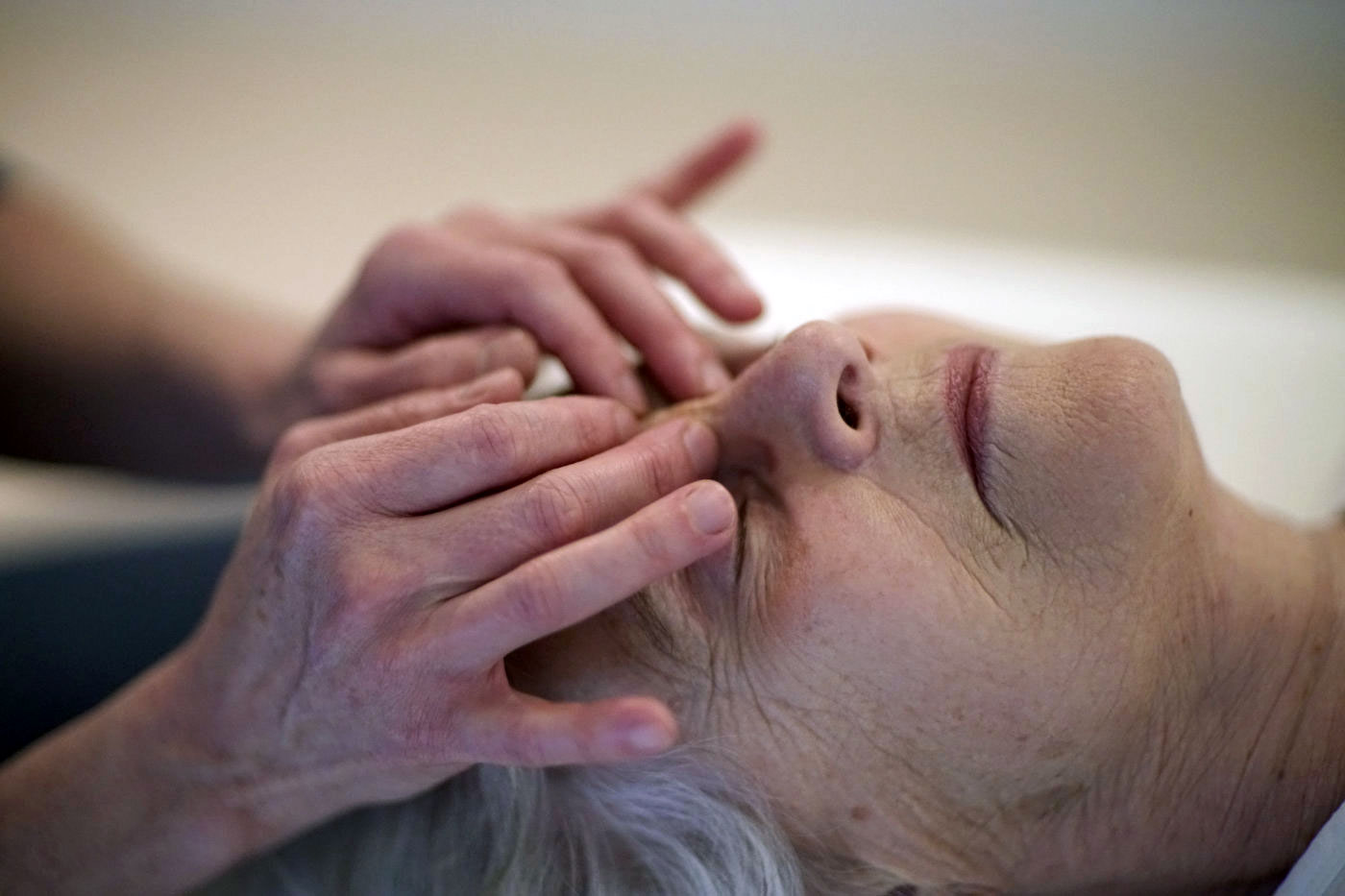 Lady receiving craniosacral therapy